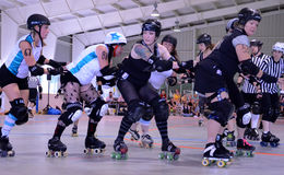 Roller derby - Defense gets ready for jammer Royalty Free Stock Photography