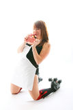 Roller derby girl eating raw steak Royalty Free Stock Image