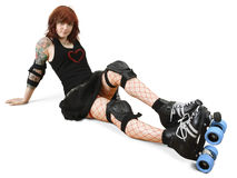Roller derby girl on the floor. Photograph of a roller derby girl posing on the floor with her equipment royalty free stock photo