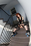 Roller derby girl on the stairs Stock Photos
