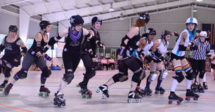 Roller derby - Jammer gets around the pack Royalty Free Stock Photo