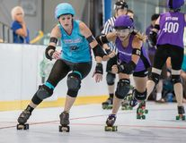Roller Derby. Skaters take position in a match with Shasta vs. Sonoma at Redding, California stock photography