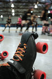 Roller derby skater knocked out Royalty Free Stock Photography
