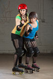 Roller Derby Skaters in Pointing Finger Royalty Free Stock Photo