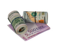 Roller of dollars and euro. On a white background stock photo