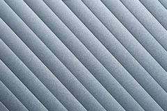 Roller Door Detail. Detail of silver grey roller door/blind with parallel striped lines Royalty Free Stock Images
