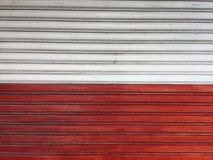 Roller door white and red color, shutter door texture background. stock photography