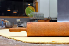 Roller and dough into the kitchen table ready for rolling Stock Images