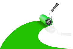 A roller dyes a green color Royalty Free Stock Images