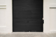 Roller garage door in black. Horizontal and empty Stock Images