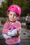 Roller girl in helmet Stock Photos