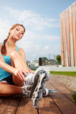 Roller girl resting on the steps Stock Photos