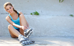 Roller girl resting on the steps Royalty Free Stock Image