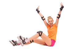 Roller girl sitting with hands raised. Stock Photography