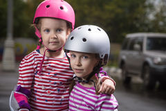 Roller girls in helmets Royalty Free Stock Image