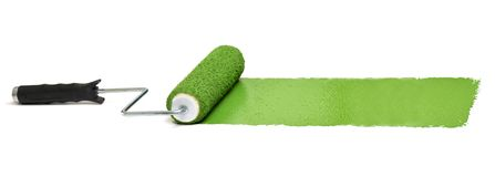 Roller with Green paint. Over white background - Stitched from three images royalty free stock photo