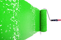 Roller With Green Paint on White Wall Royalty Free Stock Image