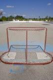 Roller Hockey Net. A net in an empty outdoor roller hockey rink Stock Photo