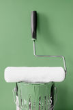 Roller and khaki green paint. Clean paint roller on top of khaki green paint can for home diy decorating Stock Images