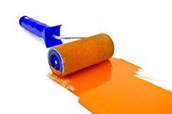 Roller with orange paint Stock Photography