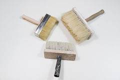 Roller and paint brush on a white background. Painting tools stock photos