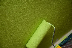 Roller paint with green texture Royalty Free Stock Photo