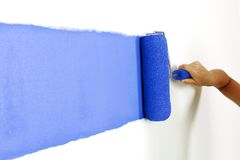 Roller with paint on the wall Royalty Free Stock Photography