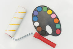 Roller for painting and palette with watercolor paints. On a white background Royalty Free Stock Photo