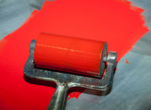 Roller printing with red ink Royalty Free Stock Photo
