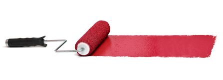 Roller with Red paint. Over white background - Stitched from three images royalty free stock photography