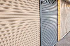 Roller shutter door of front gate Stock Photos