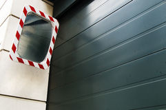 Roller shutter garage door with mirror Royalty Free Stock Photography