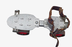 Roller skate. Old steel roller skate with leather strap four wheels with clipping path Royalty Free Stock Photography