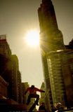 Roller skater. Flying between the buildings in downtown New York city Royalty Free Stock Photo