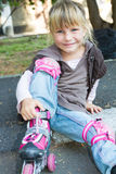 Roller skater - child girl - in protective equipment si Stock Image