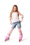 Roller skater child girl on the rollers. Stock Images