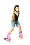 Roller skater child girl on the rollers. Stock Images