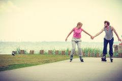 Roller skater couple skating outdoor Royalty Free Stock Photos