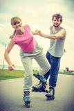 Roller skater couple skating outdoor Stock Image
