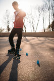 Roller skater rides the snake, rollerskating trick. Exercise in park. Male rollerskater leisure on sidewalk Stock Images