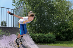 Roller skater speeding down a ramp Royalty Free Stock Image