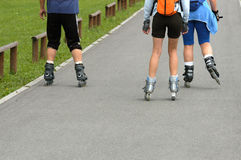 Roller skates. Family on roller skates outdoor Royalty Free Stock Photography