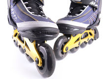 Roller skates. A pair of roller skates on a white background Royalty Free Stock Photography