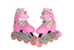 Roller skates. Pink roller skates are photographed on a white background Royalty Free Stock Image