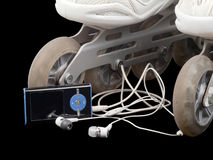 Roller skates and mp3 player with headphones Royalty Free Stock Image