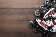 Roller skates on table stock photo