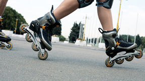 Roller skates trick Royalty Free Stock Images