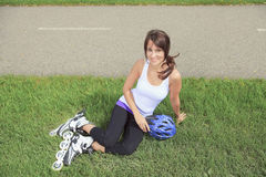 A Roller skating girl in park rollerblading on Stock Images