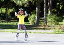 Roller skating happy little girl Stock Photos