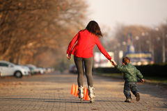 Roller skating mother and child Royalty Free Stock Images